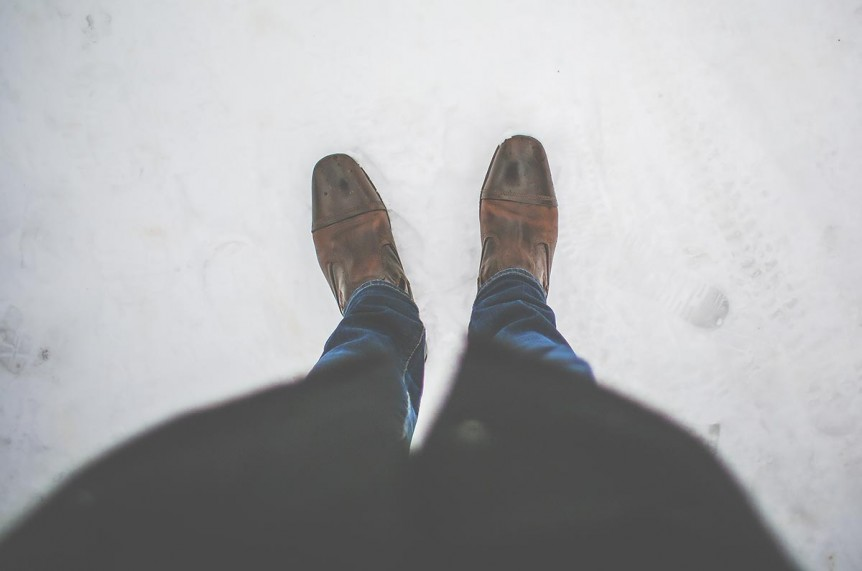 Looking down at a man's shoes. You can get help for stress in hillsboro, or and online therapy in Oregon at Life Discovery Counseling on the eastside and westside. christian anxiety counseling in clackamas, or