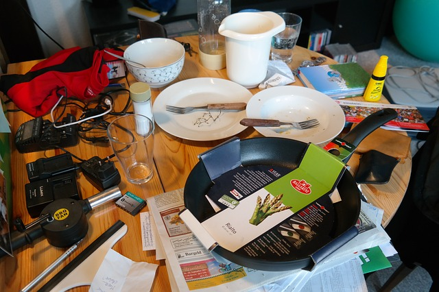 The table is in disarray with plates and unclean bowls. Electronic tools, paper, and an unused pan is present | Coping with Disorganized attachment | Counselors in the Happy Valley, Damascus, Clackamas and Hillsboro, OR at Life Discovery Christian Counseling can help