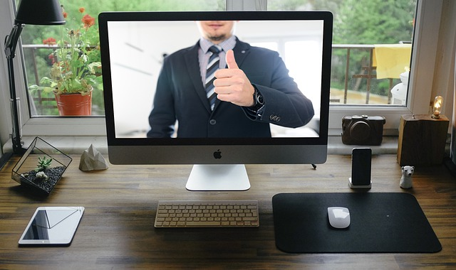 Man on a screen with thumbs up, computer monitor on desk displaying video therapy in Oregon with a caring, Christian counselor in Portland, OR. Contact us to start Online therapy in Oregon today.