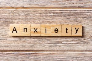 ANXIETY word written on wood block. You can get help for stress in hillsboro, or and online therapy in Oregon at Life Discovery Counseling on the eastside and westside. christian anxiety counseling in clackamas, or