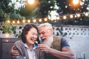 Happy senior couple having fun at dinner house party. You can get christian marriage counseling in hillsboro, or on the westside near Portland, OR and with online therapy in Oregon with Christian couples counseling in video therapy in Oregon. 97123