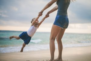 Mother turns her daughter by the arms. She needs postpartum counseling with a christian therapist in Clackams, OR or Hillsboro, OR with a postpartum support specialist.