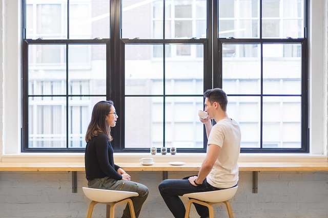 Couple sitting at a table by a window, talking and eating. They have found Christian marriage counseling in Hillsboro, OR and Clackamas, OR helpful for connecting. They can get help with their emotions with quality marriage counseling and couples therapy with a christian counselor. Get online therapy in Oregon here!