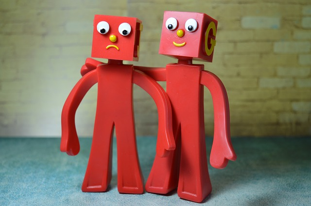 Gumby-like figures in red, one looking sad and one looking reassuring with its arm around the sad one. Human beings need connection with others to thrive, so  you can be supported by a Christian therapist in Christian counseling in Hillsboro, OR and  Christian therapy in Clackamas, OR here.