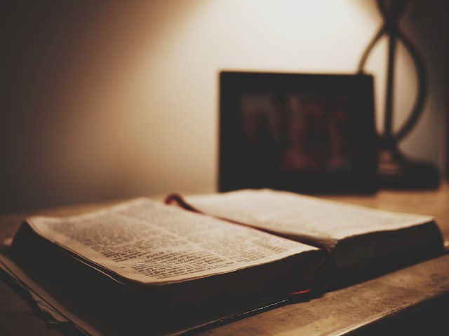 Open bible with bookmark lit by low lamplight. You might be needing counseling for lament, anxiety, depression or other topics a Christian counselor in Clackamas, OR can help with. Get Christian Counseling in Hillsboro, OR here with online therapy in Oregon.