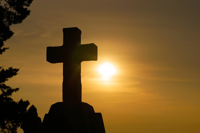 image of a stone cross at sunset this represents the value of working with a christian therapist for online therapy in Oregon to get christian counseling with a Christian counselor in Clackamas, OR or Hillsboro, OR.