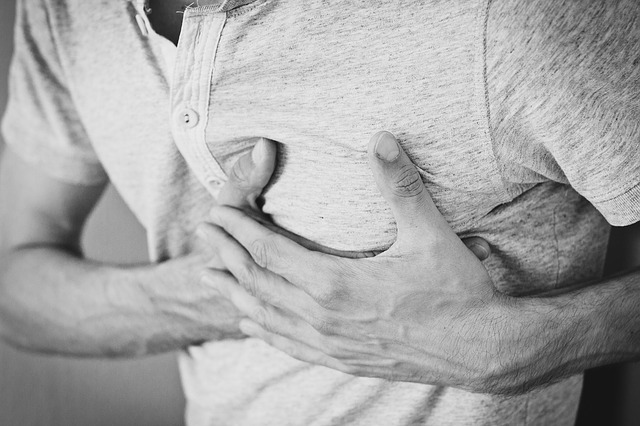 Man clutches his chest in anxiety and pain. Emotional pain can manifest in physical pain. Anxiety, depression, relationship problems and more can be felt. Read more from a Christian therapist in Clackamas, OR here.