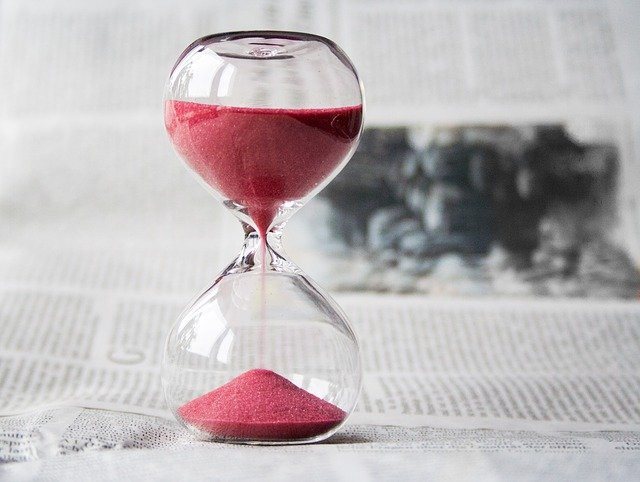 image of an hourglass with red sand representing the passing of time and the importance of waiting while you lament. Consider working with an Oregon therapist who offers christian counseling in Clackamas, OR to address the issues that matter most to you.