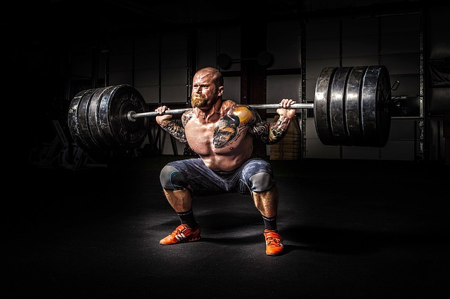 Man lifting very heavy weights. You may feel like the weight of the world is on your shoulders when dealing with anxiety, depression, grief and more. Visit a Christian counselor in Hillsboro, OR for online therapy in Oregon.