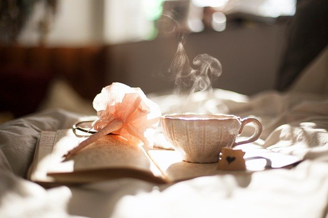 Steaming cup of tea with a journal and pen on a soft surface. You can feel more grounded and confident with Christian counseling in Hillsboro, OR and Clackamas, OR. Connect with a Christian counselor today.
