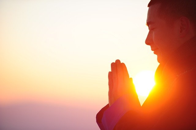 Man meditating in the sunset. A Christian counselor in Hillsboro, OR and a faith-based therapist in Clackamas, OR can talk with you for anxiety, marriage counseling, codependency treatment, depression and more.