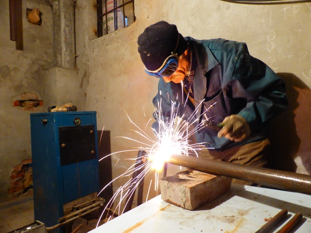 Worker doing metal working in a shop. Purpose can help you feel better at work. Get online counseling in oregon with a Christian therapist for worry in Clackamas, OR and beyond.